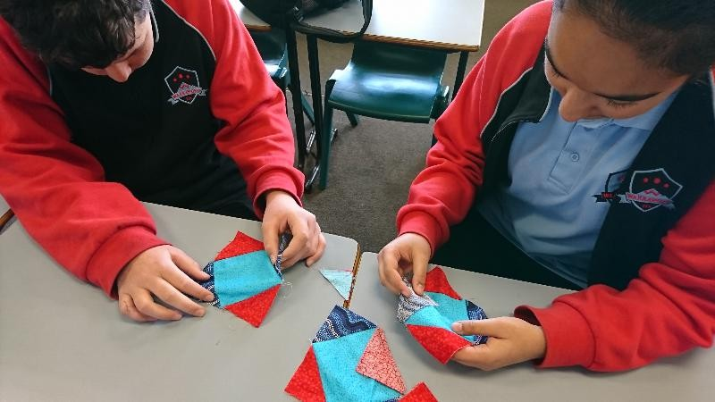 Year 7 Quilting Project incorporating perimeter, area and tessellations.